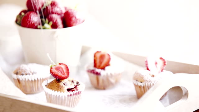 Food footage: strawberry cupcakes are being sprinkled upon with sugar powder video