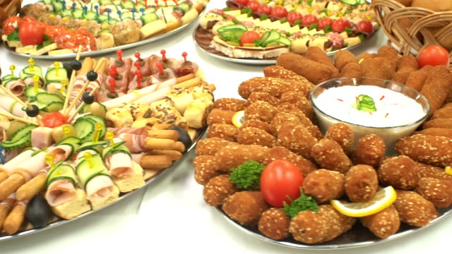 food on party table - buffet video stock e b–roll