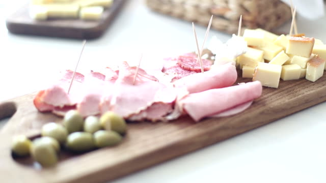 Food on the table Food on the table aperitif stock videos & royalty-free footage