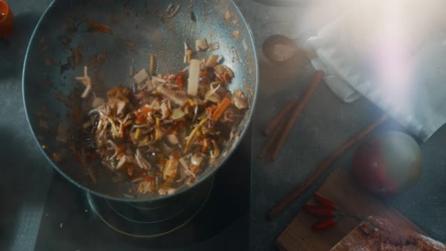 Food preparation Close up view of a frying pan with vegetables in it and stir frying technique. stir fried stock videos & royalty-free footage