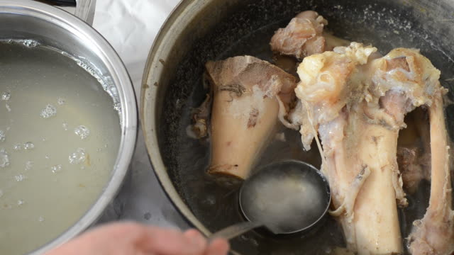 Food Taking broth with ladle from the saucepan. flower pot stock videos & royalty-free footage