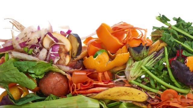 Food Waste. Compostable Food Scraps, time lapse. Domestic waste for compost from fruits and vegetables. leftovers stock videos & royalty-free footage