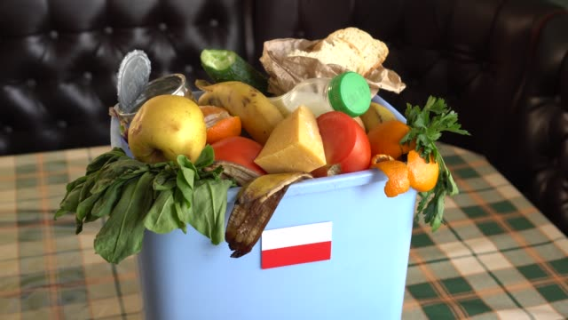 Food waste in the garbage bin. The problem of food waste in Poland Food waste in the garbage bin. The problem of food waste in Poland. Recycling, Trash, Donating and Composting leftovers stock videos & royalty-free footage