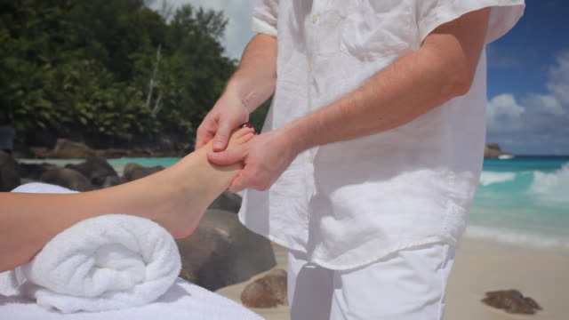 foot massage on the beach video