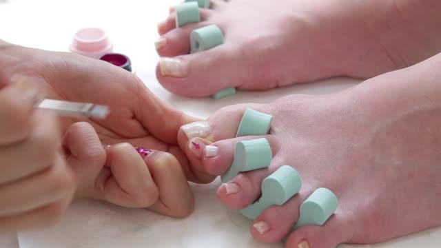 foot nail (pedicure) - pedicure filmów i materiałów b-roll