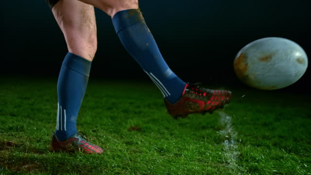 SLO MO Foot of a female rugby player kicking the ball Slow motion medium shot of the leg of a female rugby player kicking the ball. Shot in Slovenia. rugby stock videos & royalty-free footage