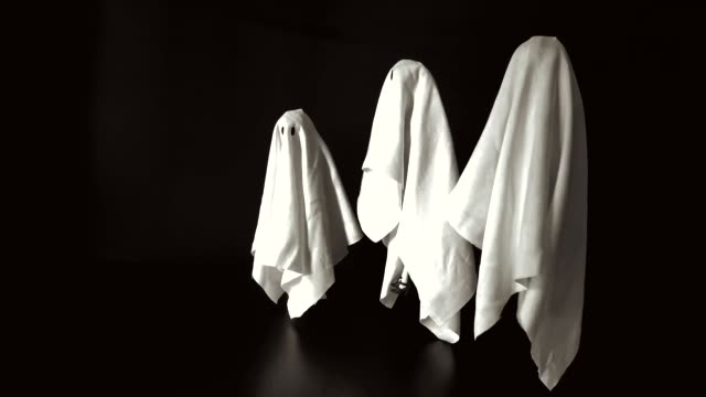 Footage a group of female ghost white sheet costume flying in the air with black background. Footage a group of female ghost white sheet costume flying in the air with black background. Minimal Halloween scary concept. ghost icon stock videos & royalty-free footage