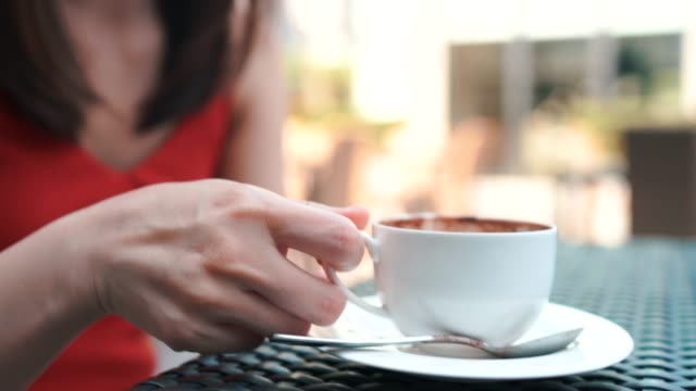 4K Footage Close up Beautiful hand and face, woman Drinking hot coffee.