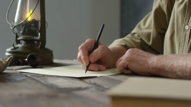 Footage Compilation of Old-Fashioned Elderly Man Writing Letter