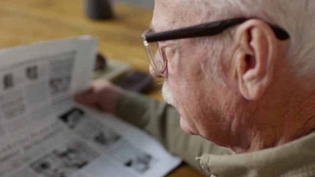 footage compilation of senior man reading zeitung - mann bart freisteller stock-videos und b-roll-filmmaterial