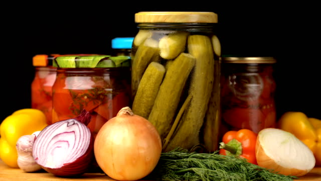 Footage glass jars with salted vegetables for the winter rotated on table Footage glass jars with salted vegetables for the winter rotated on table. 4k video pickle stock videos & royalty-free footage