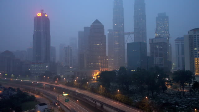 HD footage. Kuala Lumpur city in the morning sunrise during severe haze. Tilt up. video