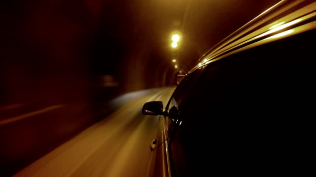 4K footage of a car going through the illuminated tunnel video