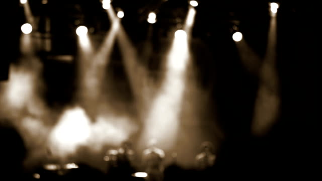 A footage of a concert with lots of smoke, blurred musicians dancing on stage video