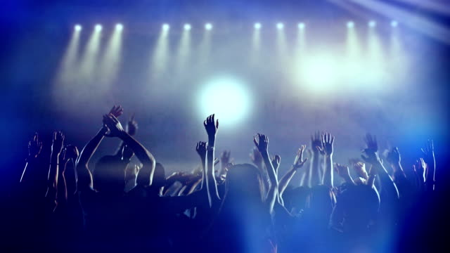 Footage of a crowd partying, dancing slow motion at a concert Footage of a crowd partying, dancing slow motion at a concert. Crowd of fans dancing, jumping, dancing. Slow motion. Shot on RED EPIC Cinema Camera. FEW SHOTS. silhouette people stock videos & royalty-free footage
