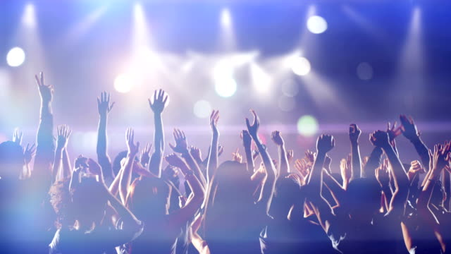 Footage of a crowd partying, dancing slow motion at a concert Footage of a crowd partying, dancing slow motion at a concert organized group stock videos & royalty-free footage