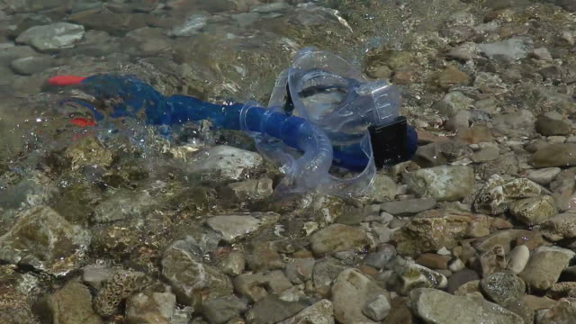Footage of a diving gear on a beach