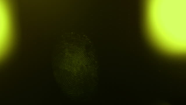 Footage of a fingerprint on a black surface and somebody checking it