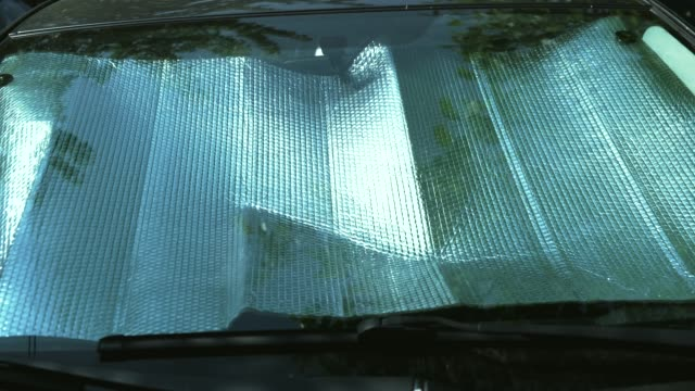 Footage of aluminum foil for protecting car by sun.