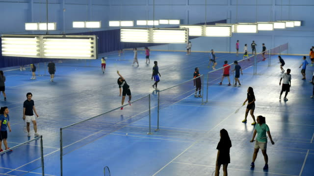 Footage of badminton courts with lots of players video