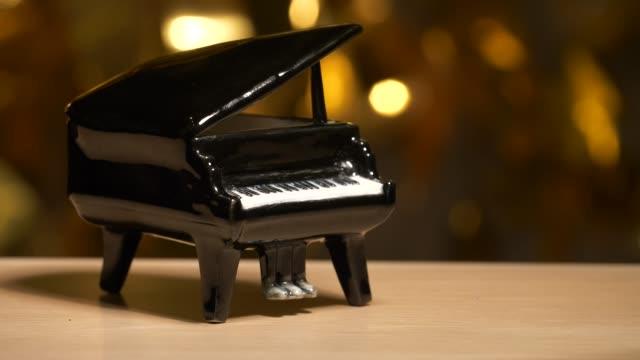 footage of black piano dark background