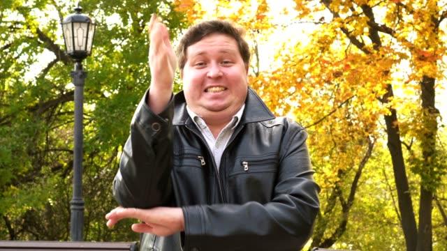 footage of happy big man raising hand