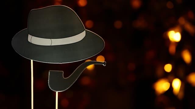 footage of hat smoking pipe dark background