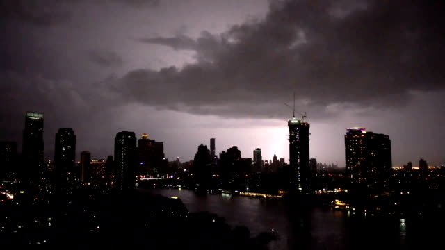 fhd footage of lightning with thunderstorm clouds at night over the bangkok cityscape river side, thailand - dramatyczne niebo filmów i materiałów b-roll