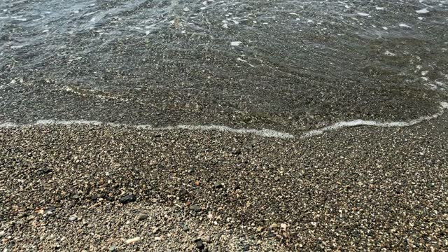 """Footage of little waves of Aegean sea and pebbles at """"Akarca"""" beach in touristic Aegean town called """"Sigacik"""". It is a village of Seferihisar district of Izmir / Turkey. Footage of little waves of Aegean sea and pebbles at """"Akarca"""" beach in touristic Aegean town called """"Sigacik"""". It is a village of Seferihisar district of Izmir / Turkey. It is a sunny summer day. aegean sea stock videos & royalty-free footage"""