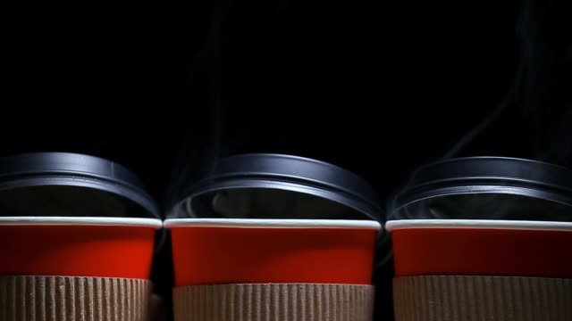 footage of paper cup smoke dark background