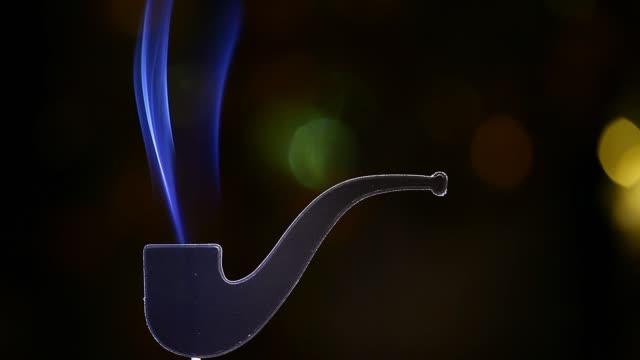 footage of smoking pipe dark background
