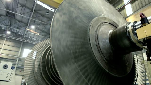 footage of spinning steam turbine at workshop