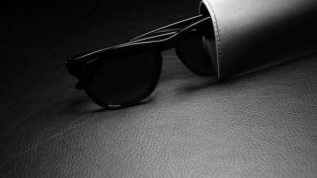 footage of sunglasses dark leather background