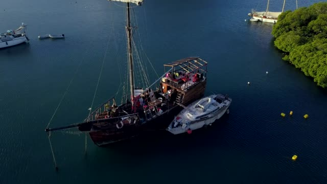 4K Footage of the Aerial View to the Martinique Marina Bay with the Old Pirate Boat in the Clear Blue Water