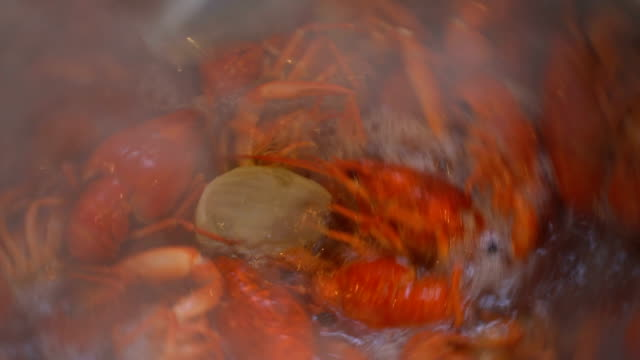 Footage red boiled crawfish closeup on a pan