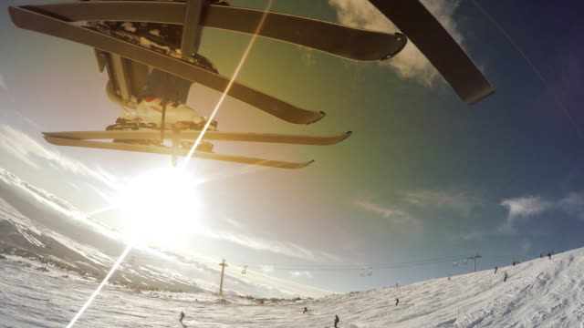 4K Footage: Skiers on the lift, beautiful sunny landscape on the background video
