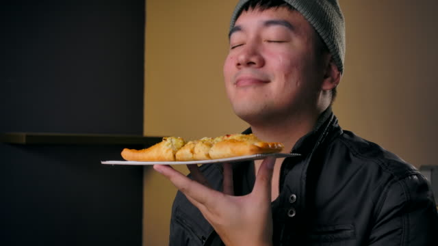 4K Footage Teenagers wear winter clothes, He is eating pizza That calls to order delivery