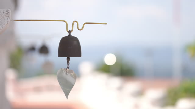 4k footage wind blowing bell in temple - buddha video stock e b–roll
