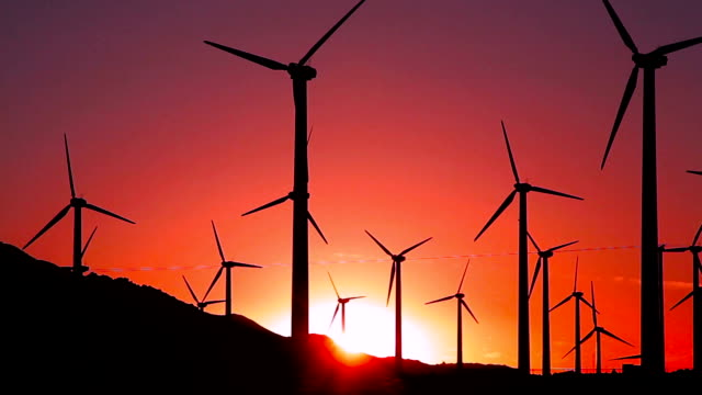 Footage - Wind Turbines at Sunset Footage - Wind Turbines at Sunset wind power stock videos & royalty-free footage