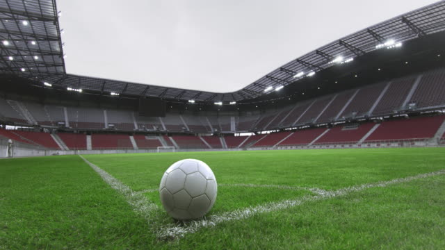 ds football ball in the corner of an empty stadium - дворец спорта стоковые видео и кадры b-roll
