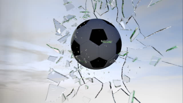 Football breaking glass slow motion video
