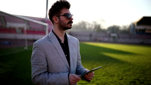 Football expert Soccer manager.Football coach analyzes footballers coach stock videos & royalty-free footage