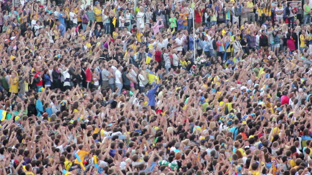 football fans celebrate a goal. unrecognizable crowd - titta bildbanksvideor och videomaterial från bakom kulisserna