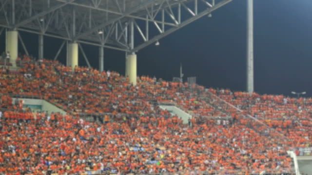 Football fans celebrate a goal. Unrecognizable crowd video