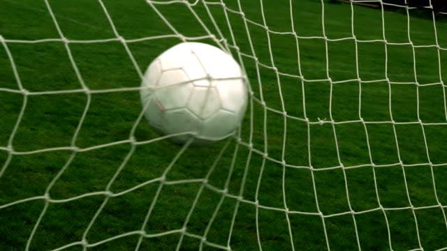 Football hitting back of the net video