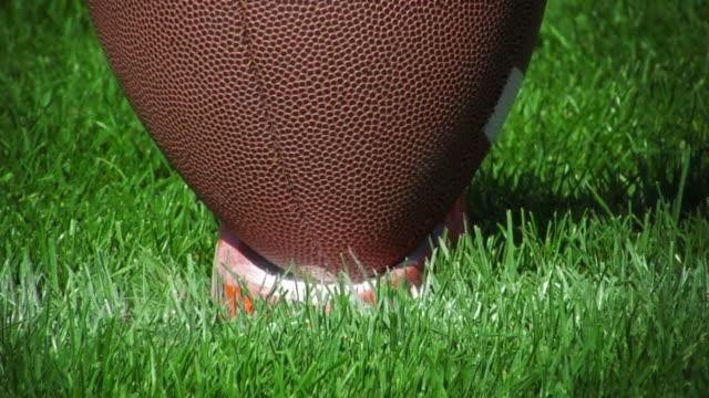 Football kicked off tee 02 (HD - Slow-Motion)  kicking stock videos & royalty-free footage