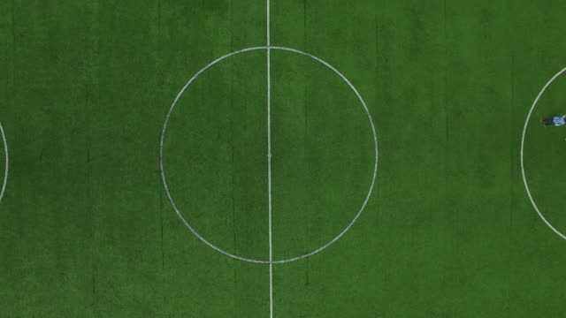 football marker on field. drone view soccer players training on football field - top filmów i materiałów b-roll