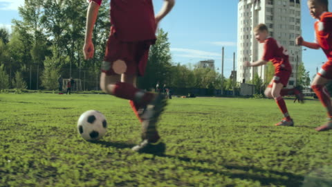 Football Match Tracking camera of two football teams passing the ball childhood stock videos & royalty-free footage