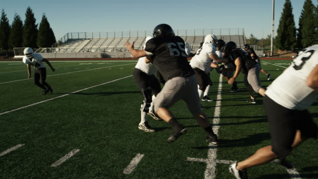 A football player gets tackled on his way to the end zone video