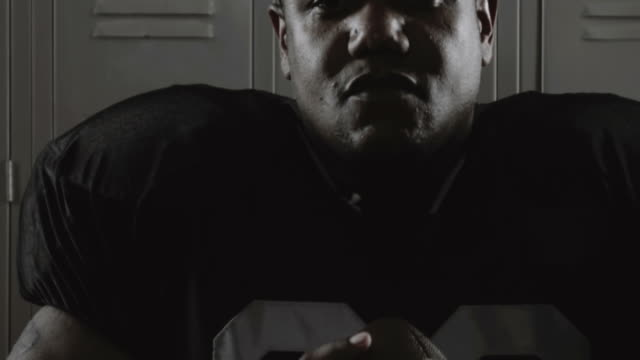 Football player gripping ball.  pre game stock videos & royalty-free footage
